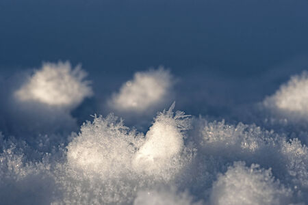 Snow with ice crystals in bright sunshine