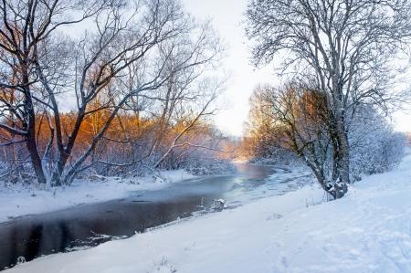 scandinavian landscape: small frozen river in beautiful Scandinavian winter landscape