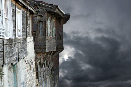 tatty: spooky old tatty wooden building on gray sky
