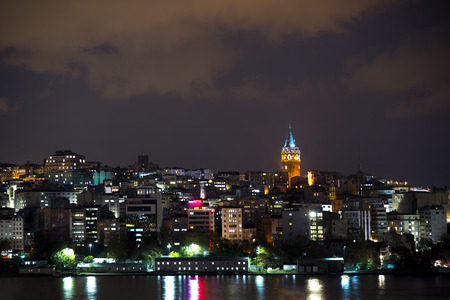 istanbul night: Night view of Galata district in Istanbul, Turkey, with Galata Tower brightly lit