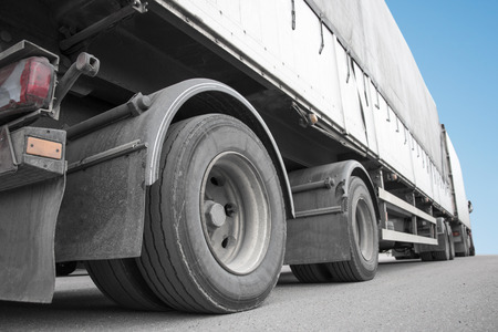 big wheel: Low angle view of big truck on asphalt Stock Photo