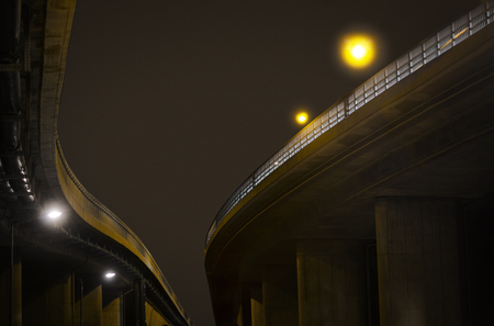 Low angle view of elevated road at night photo
