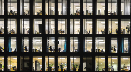 Windows of office building at night