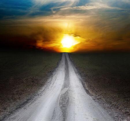 dawning: small rural dirt road leading towards dawn