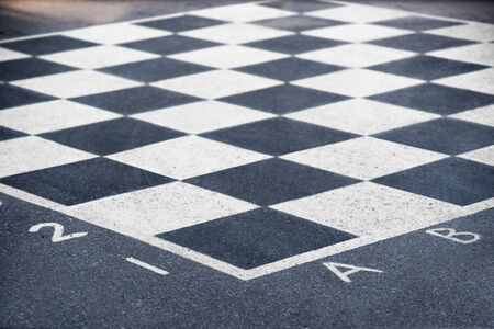 grey scale: Close up of chess board painted on asphalt Stock Photo
