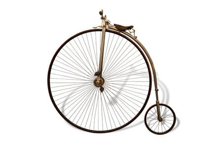 Vintage fiets met schaduw op wit wordt geïsoleerd