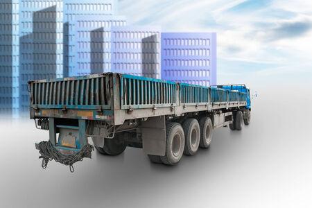 sky scraper: Rear view of long truck trailer in urban environment Stock Photo