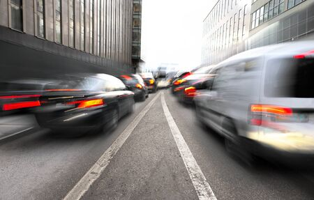 merging: Busy urban traffic with merging lanes in blurred motion Stock Photo