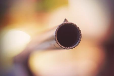 holdup: Close up of barrel of vintage shotgun