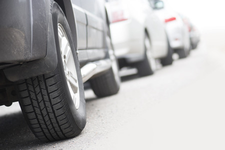 waiting in line: Low angle view of tire of car in traffic jam