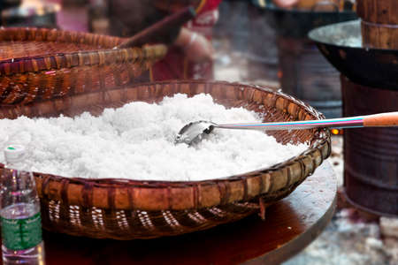 steaming: Big wooden bowl of steaming white rice in Chinese restaurant Stock Photo