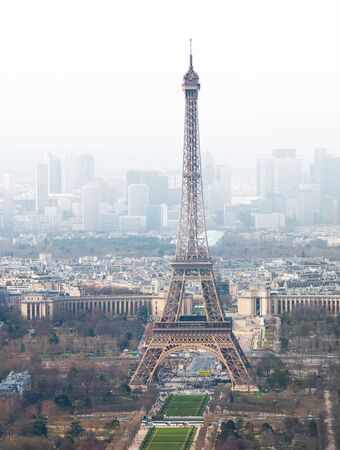 la defense: High angle view of Eiffel tower in Paris, France, with la defense in foggy white background