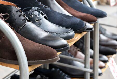 mens shoes: Mens shoes on display on rack outside shoeshop