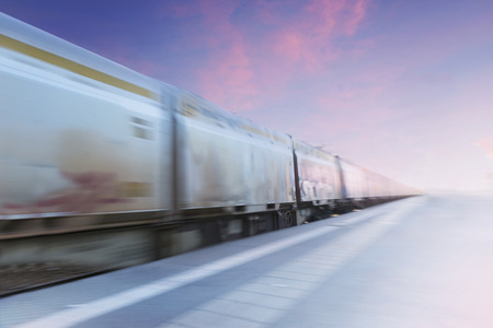 freight train: Freight train in blurred motion on purple and blue evening sky