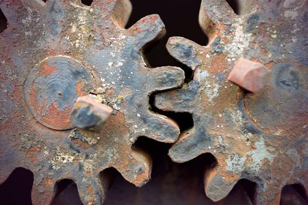 compatibility: Close up of two rusty vintage cogwheels