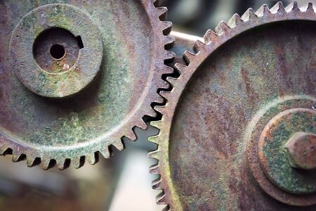 compatible: Close up of two rusty vintage cogwheels