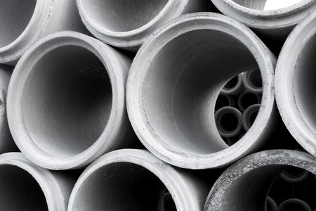 cement pile: Close up of pile of concrete pipes
