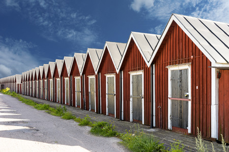 boathouse: Row of traditional red wooden boathouses in small Swedish town Stock Photo