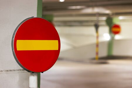 car park interior: Close up of one way sign in parking garage