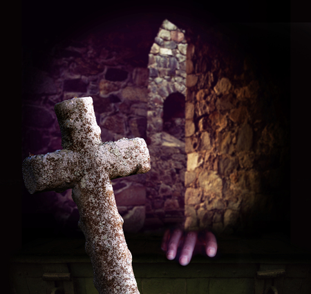crypt: Crypt with ancient stone cross and purple hand appearing, trying to get a grip on old chest or coffin Stock Photo