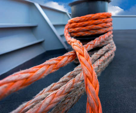 ship deck: Close up of strong orange rope on ship deck