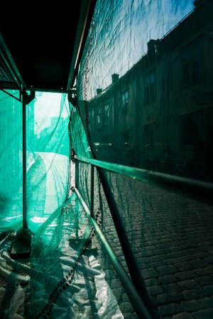 debris: inside green debris netting of scaffolding in city