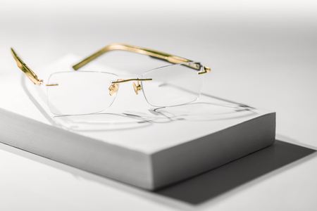 sparse: Sparse image with reading glasses on book Stock Photo