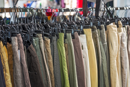 second hand: Recycled trousers for sale in second hand shop