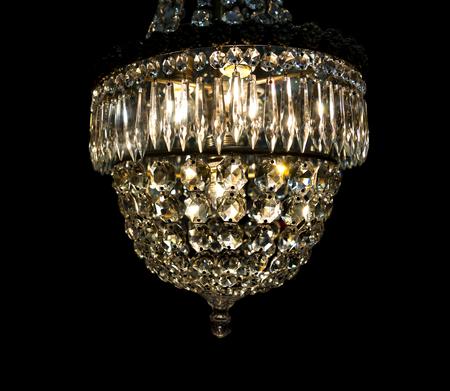 vintage chandelier: Vintage chandelier with glass prisms on black background