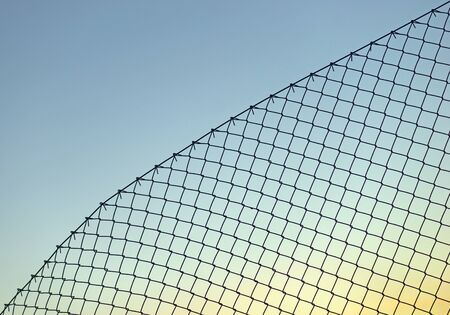 chain link fence: Background with chain link fence on blue sky