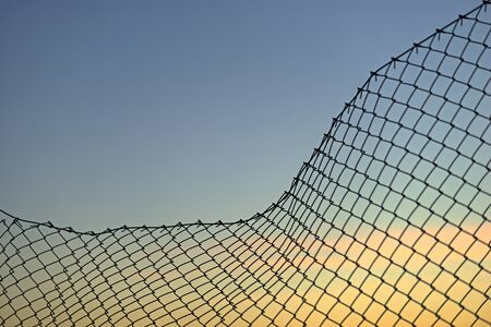 chain link fence: Background with chain link fence on evening sky