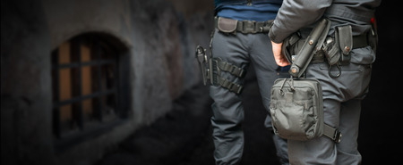 holster: Armed policemen on guard in street at night