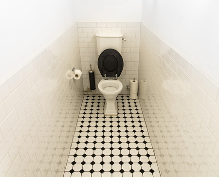 Toilet with open black seat in public restroom