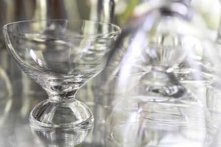 the shelf: Close up of glass on shelf with reflection Stock Photo