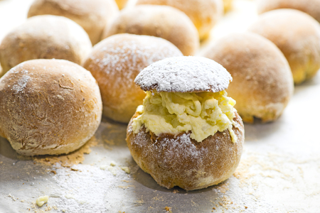 Traditional Swedish easter bun filled with almond paste and cream, fresh from oven Stock Photo