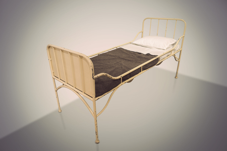 retrospective: vintage metal hospital bed on neutral background Stock Photo