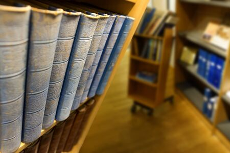 backs: Vintage books with blue backs in shelf in library