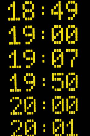 departure: Close up of times on departure or arrival board for trains or other means of transport