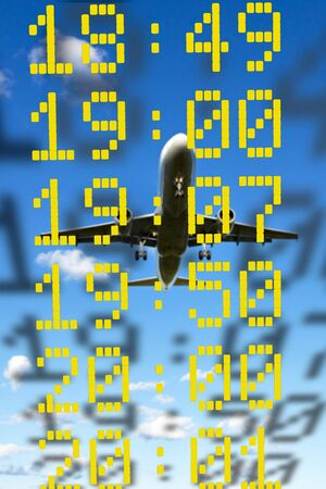 departure: Close up of times of departure or arrival on blue sky with aircraft