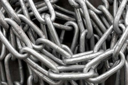 heap up: Close up of heap of shiny metal chain Stock Photo