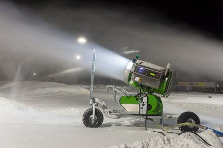 Snow gun by ski slope