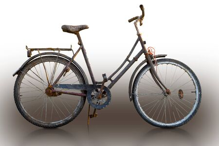 Rusty bike on sparse background, with reflection in floor
