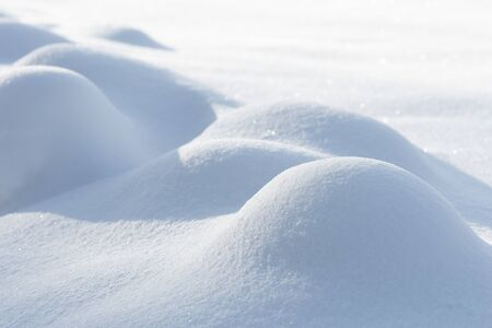 smooth snow surface with small bumps on sunny winter day
