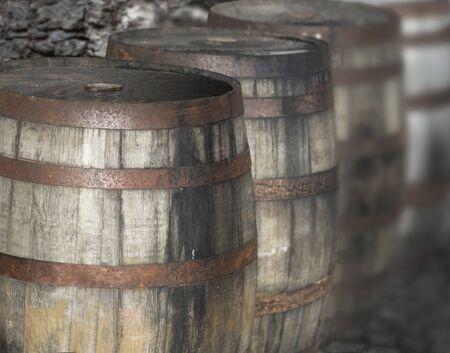 Row of vintage wooden barrels with rusty metal Archivio Fotografico