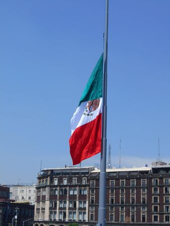 mexican flag in the zocalo at half of its way because someone die