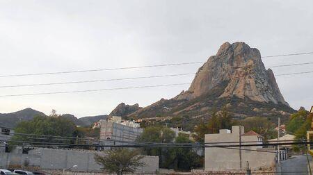 The peña de bernal in Queretaro Mexico at far