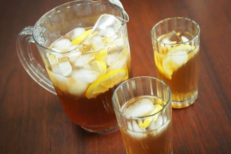 Pitche and glasses with ice tea photo