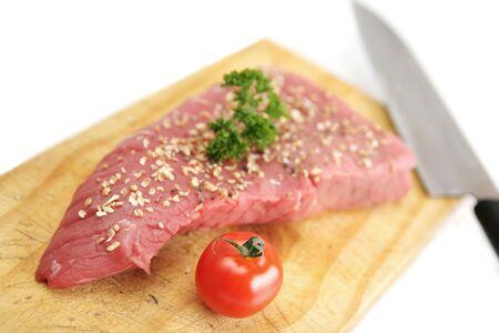 Raw steak with spices on a cutting board  Stok Fotoğraf