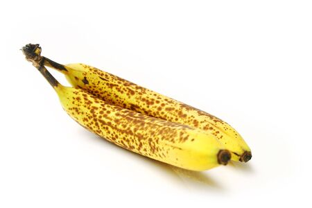 Two bananas with brown spot isolated on white background Stock Photo - 7812911
