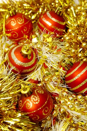 Red and gold  christmas balls in gold tinsel photo